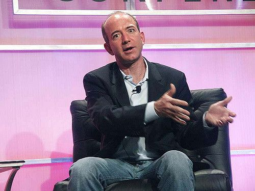 Amazon's leader and CEO seated on stage explaining business.