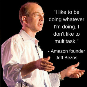Amazon's leader Jeff Bezos standing delivering a quote.
